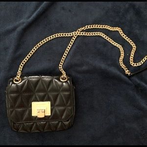 Small Michael Kors black handbag.